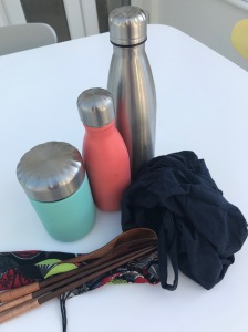 Reusable bottles, cutlery and food pot for greener eating while travelling